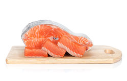 Raw salmon on cutting board. Isolated on white background Stock Photography