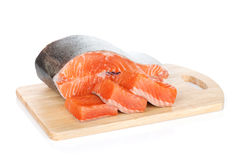 Raw salmon on cutting board Stock Images