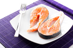 Raw salmon on dish Royalty Free Stock Photo