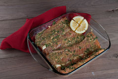 Raw Salmon Filet with Lemon and Greens,  Ready to Grill Royalty Free Stock Image