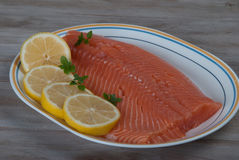 Raw Salmon Filet with Lemon. Stock Photo