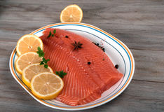 Raw Salmon Filet with Lemon. Royalty Free Stock Photos