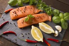 Raw salmon filet with lemon Royalty Free Stock Image
