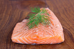 Raw salmon filet. Picture of a piece of raw salmon filet stock photography
