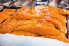 Raw salmon filet on supermarket stall. Fresh  nordic fish Royalty Free Stock Photos
