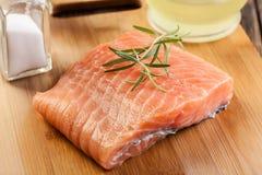 Raw salmon filet on wooden cutting board Stock Image