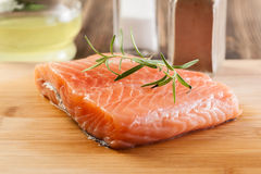 Raw salmon filet on wooden cutting board Royalty Free Stock Photography