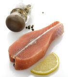 Raw Salmon Fillet. With Lemon And Spices Royalty Free Stock Photo