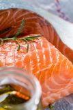 Raw Salmon Fillet with Aromatic Herbs and Spices. Fresh Raw Salmon Fillet with Aromatic Herbs and Spices on White Paper Stock Images