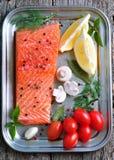 Raw salmon fillet with cherry tomato, mushroom, dill, garlic, lemon and sea salt Stock Photos