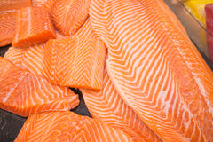 Raw salmon fillet. Close up of fresh Raw salmon fillet on cooking table Royalty Free Stock Photos