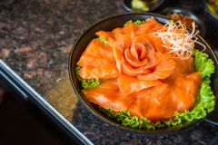 Raw salmon fillet on dish with wasabi in restaurant,Japanese food style. Raw salmons fillet on dish with wasabi in restaurant,Japanese food style Stock Image