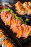 Raw salmon fillet on dish with wasabi in restaurant. Raw salmons fillet on dish with wasabi in restaurant Stock Photography