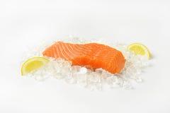 Raw salmon fillet. On ice Stock Photo