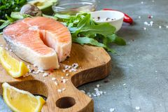 Raw salmon fillet and ingredients for cooking Royalty Free Stock Photography