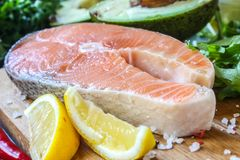 Raw salmon fillet and ingredients for cooking Stock Images