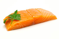 Raw salmon fillet isolated. Raw salmon steak with parsley  on white background Stock Photos
