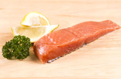 Raw salmon fillet. With lemon and parsley Royalty Free Stock Photo