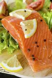 Raw salmon fillet with lemon and pepper. Prepared for cooking Royalty Free Stock Photography