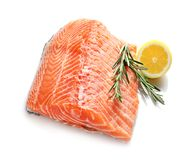 Raw salmon fillet with lemon and rosemary. On white background Royalty Free Stock Photos