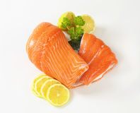 Raw salmon fillet. And lemon slices on white background Royalty Free Stock Image