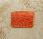 Raw salmon fillet. On marble background. top view Stock Image