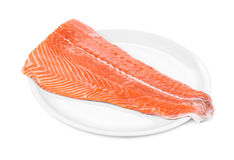 Raw salmon fillet on plate. Stock Image
