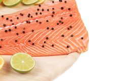 Raw salmon fillet on platter. Isolated on a white background Stock Images