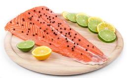Raw salmon fillet on platter. Royalty Free Stock Image