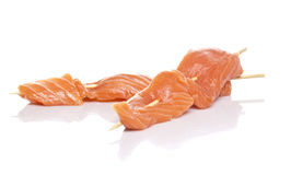 Raw salmon fillet on a skewers Stock Photo