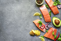 Raw salmon fillet with spice and vegetables.Top view with copy s. Raw salmon fillet with spice and vegetables on a grey slate,stone or concrete background.Top Stock Photos