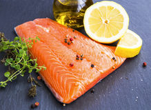 Raw salmon fillet with spices and lemon. Raw salmon fillet seasoned with spices and lemon Stock Photography