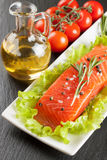 Raw salmon fillet. Spices and vegetables on a white plate Royalty Free Stock Photography