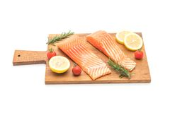 Raw salmon fillet with tomatoes lemon rosemary pepper and salt. Isolated on white background Royalty Free Stock Image
