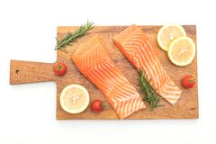 Raw salmon fillet with tomatoes lemon rosemary pepper and salt. Isolated on white background Stock Photos