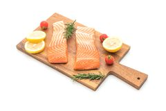 Raw salmon fillet with tomatoes lemon rosemary pepper and salt. Isolated on white background Royalty Free Stock Photo
