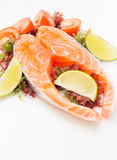 Raw salmon fillet with vegetables. On white background Stock Image