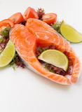 Raw salmon fillet with vegetables. On white background Royalty Free Stock Photos