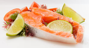 Raw salmon fillet with vegetables. On white background Stock Photo