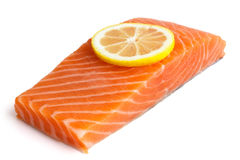 Raw salmon fillet on white. Lemon slice Stock Photography