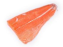 Raw salmon fillet on white plate. Stock Photos
