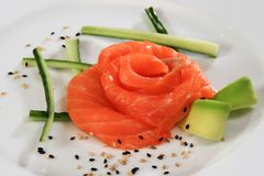 Raw salmon fillet on white plate. Asian food Stock Images