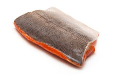 Raw Salmon Fillet on White. Wild Alaskan Sockeye or Coho Salmon fillet isolated on a white background Royalty Free Stock Photography