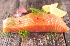 Raw salmon fillet. On wood background Stock Image