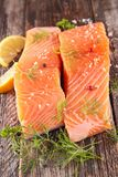 Raw salmon fillet. On wood background Royalty Free Stock Images