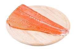 Raw salmon fillet on wood platter. Isolated on a white background Stock Image