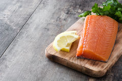 Raw salmon fillet on wooden background. Fresh raw salmon fillet on wooden background Royalty Free Stock Photo