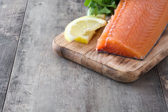 Raw salmon fillet on wooden background. Healthy raw salmon fillet on wooden background Royalty Free Stock Photography