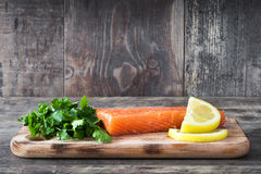 Raw salmon fillet on wooden background. Raw salmon fillet on wooden table background Royalty Free Stock Photography