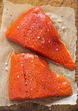 Raw salmon fillets seasoned Royalty Free Stock Image